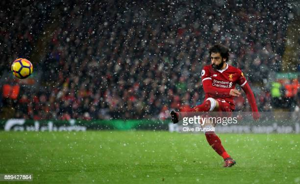 Mohamed Salah of Liverpool shoots during the Premier League match between Liverpool and Everton at Anfield on December 10 2017 in Liverpool England