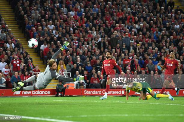 Mohamed Salah of Liverpool shoots wide uring the Premier League match between Liverpool FC and Norwich City at Anfield on August 09 2019 in Liverpool...