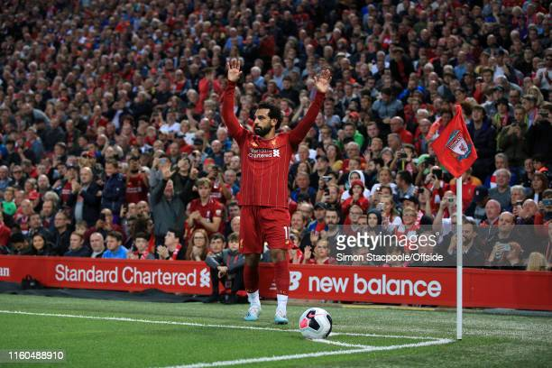 Mohamed Salah of Liverpool signals before taking a corner during the Premier League match between Liverpool and Norwich City at Anfield on August 9...
