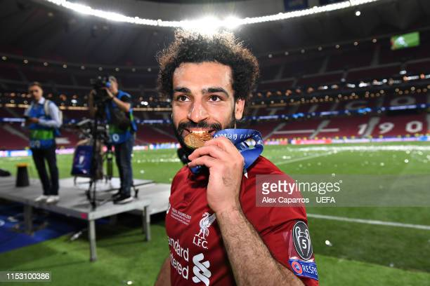 Mohamed Salah of Liverpool smiles as he celebrates victory in the UEFA Champions League Final between Tottenham Hotspur and Liverpool at Estadio...