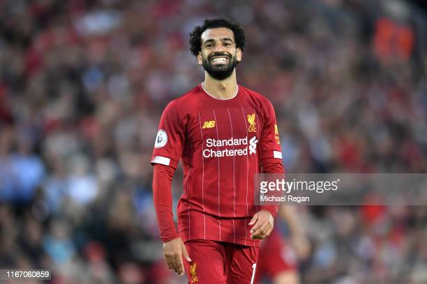 Mohamed Salah of Liverpool smiles during the Premier League match between Liverpool FC and Norwich City at Anfield on August 09, 2019 in Liverpool,...