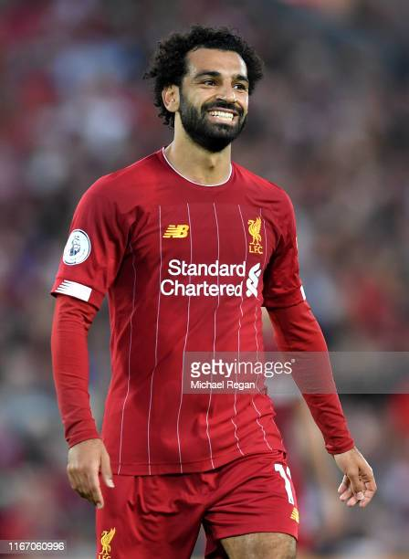 Mohamed Salah of Liverpool smiles during the Premier League match between Liverpool FC and Norwich City at Anfield on August 09 2019 in Liverpool...