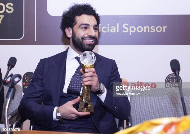 Mohamed Salah of Liverpool speaks to the press after he received the African Player of the Year award during the 2017 CAF Awards ceremony at the...
