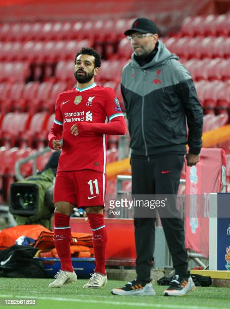 Mohamed Salah of Liverpool speaks with Jurgen Klopp Manager of Liverpool before he enters the pitch during the UEFA Champions League Group D stage...