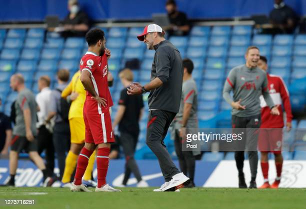 Mohamed Salah of Liverpool speaks with Jurgen Klopp Manager of Liverpool following the Premier League match between Chelsea and Liverpool at Stamford...