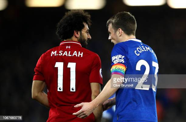 Mohamed Salah of Liverpool speaks with Seamus Coleman of Everton during the Premier League match between Liverpool FC and Everton FC at Anfield on...