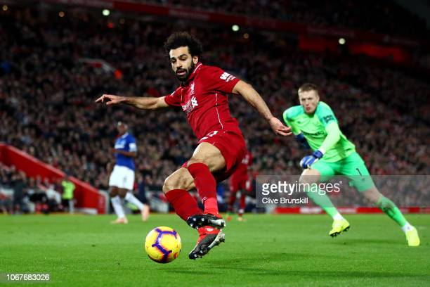Mohamed Salah of Liverpool stretches for the ball during the Premier League match between Liverpool FC and Everton FC at Anfield on December 2 2018...