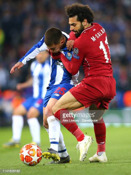 Mohamed Salah of Liverpool tackles Otavio Edmilson da Silva Monteiro of Porto during the UEFA Champions League Quarter Final first leg match between...