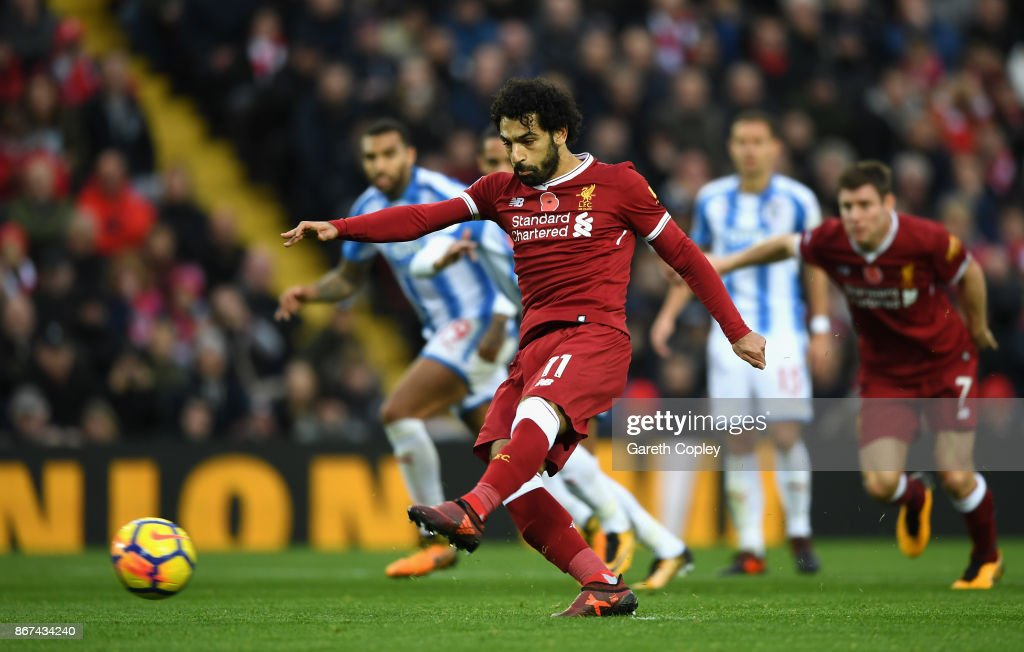 Mohamed Salah of Liverpool takes a penalty during the Premier League match between Liverpool and Huddersfield Town at Anfield on October 28, 2017 in Liverpool, England.
