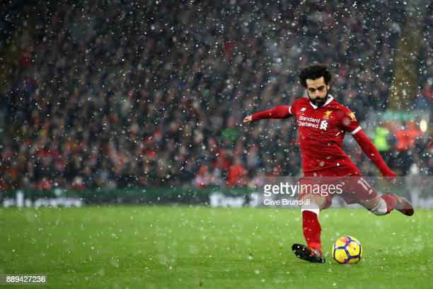 Mohamed Salah of Liverpool takes a shot during the Premier League match between Liverpool and Everton at Anfield on December 10 2017 in Liverpool...