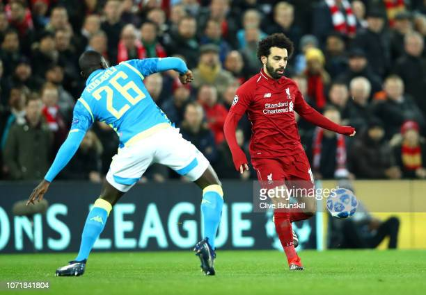 Mohamed Salah of Liverpool takes on Kalidou Koulibaly of Napoli during the UEFA Champions League Group C match between Liverpool and SSC Napoli at...