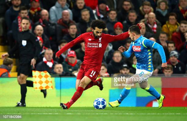 Mohamed Salah of Liverpool takes on Mario Rui of Napoli during the UEFA Champions League Group C match between Liverpool and SSC Napoli at Anfield on...