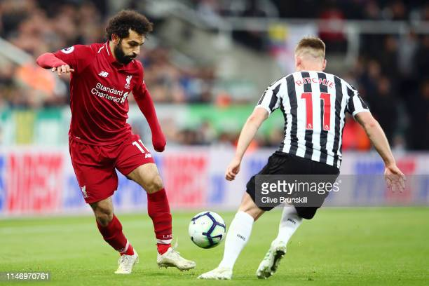Mohamed Salah of Liverpool takes on Matt Ritchie of Newcastle United during the Premier League match between Newcastle United and Liverpool FC at St...