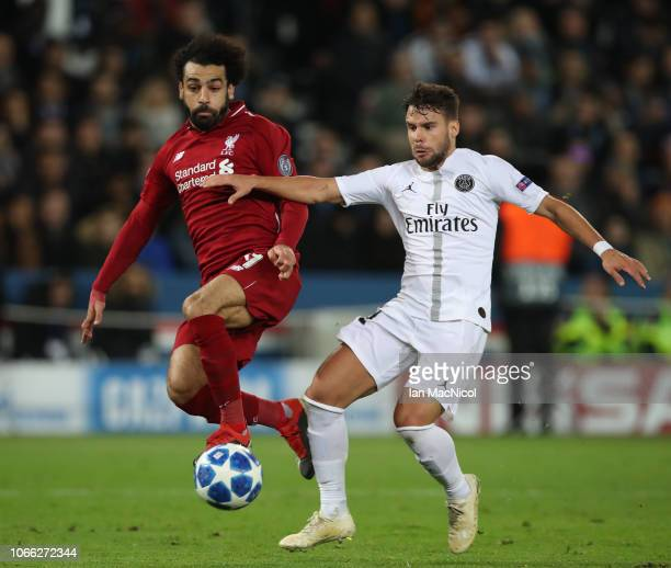 Mohamed Salah of Liverpool vies with Juan Bernat of Paris SaintGermain during the Group C match of the UEFA Champions League between Paris...