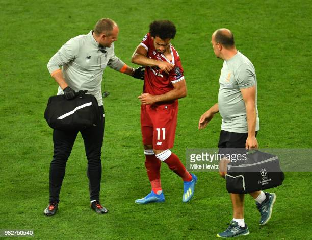 Mohamed Salah of Liverpool walks off injured during the UEFA Champions League Final between Real Madrid and Liverpool at NSC Olimpiyskiy Stadium on...