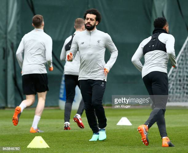 Mohamed Salah of Liverpool warms up during a training session on April 9 2018 in Liverpool England