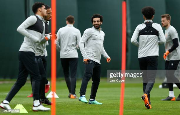 Mohamed Salah of Liverpool warms up with team mates during a training session on April 23 2018 in Liverpool England