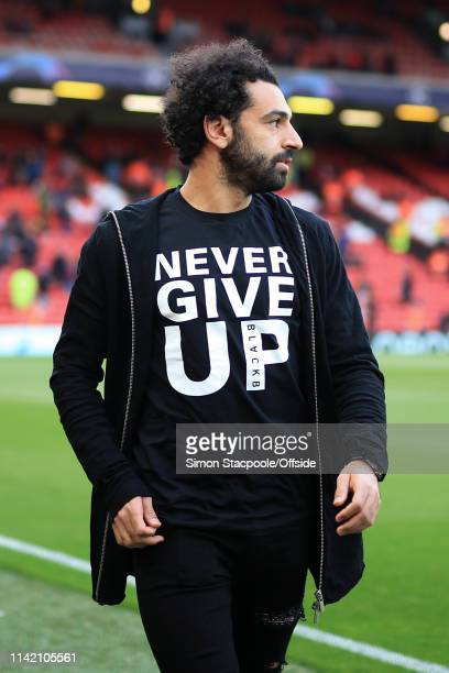 Mohamed Salah of Liverpool wears a tshirt reading 'Never Give Up' as he arrives for the UEFA Champions League Semi Final second leg match between...