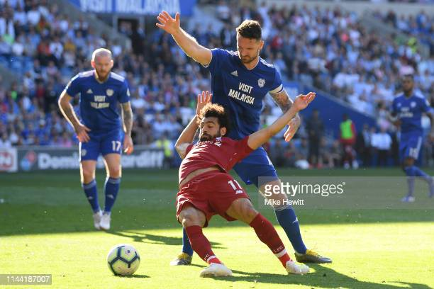 Mohamed Salah of Liverpool wins a penalty after being fouled by Sean Morrison of Cardiff City during the Premier League match between Cardiff City...