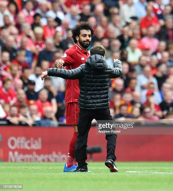 Mohamed Salah of Liverpool with a Liverpool fan during the Premier League match between Liverpool FC and West Ham United at Anfield on August 12 2018...