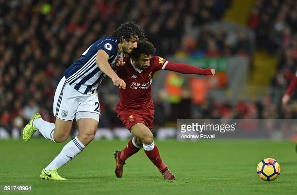 Mohamed Salah of Liverpool with Ahmed Hegazi of west Brom during the Premier League match between Liverpool and West Bromwich Albion at Anfield on...