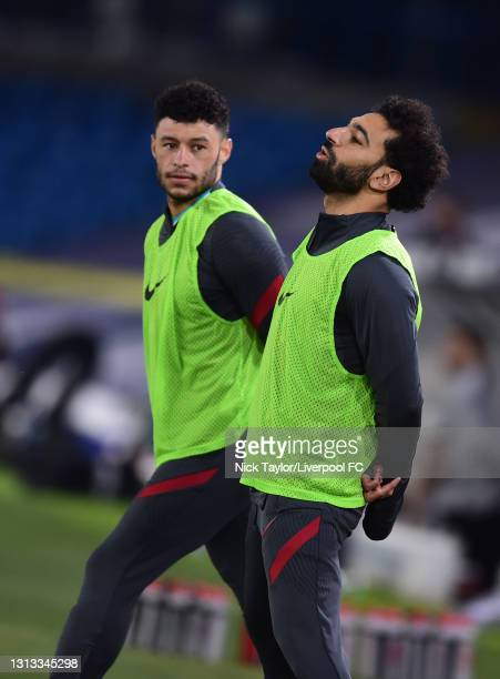 Mohamed Salah of Liverpool with Alex Oxlade-Chamberlain of Liverpool during the Premier League match between Leeds United and Liverpool at Elland...