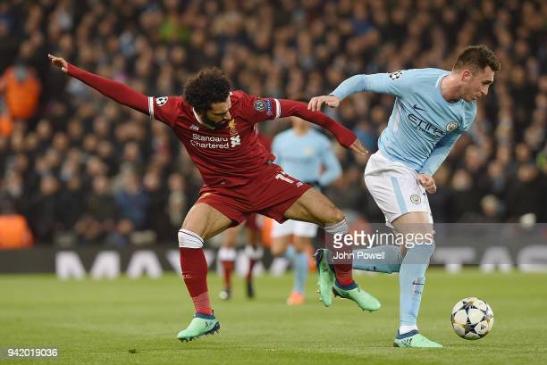 Mohamed Salah of Liverpool with Aymeric Laporte of Manchester city during the UEFA Champions League Quarter Final Leg One match between Liverpool and...