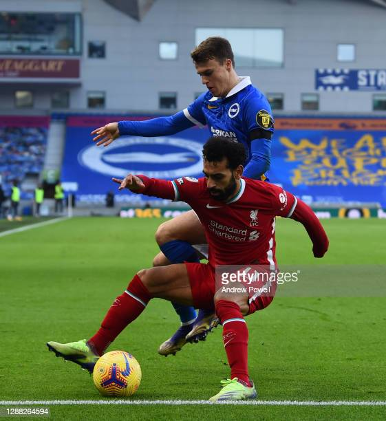Mohamed Salah of Liverpool with Brighton & Hove Albion's Lewis Dunk during the Premier League match between Brighton & Hove Albion and Liverpool at...
