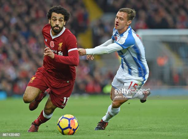 Mohamed Salah of Liverpool with Chris Lowe of Huddersfield during the Premier League match between Liverpool and Huddersfield Town at Anfield on...