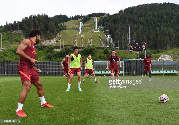 Mohamed Salah of Liverpool with Curtis Jones of Liverpool and Andy Robertson of Liverpool during a training session on July 25, 2021 in UNSPECIFIED,...
