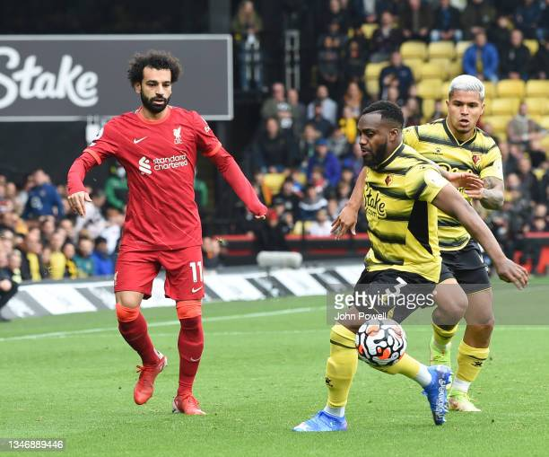Mohamed Salah of Liverpool with Danny Rose of watford during the Premier League match between Watford and Liverpool at Vicarage Road on October 16,...