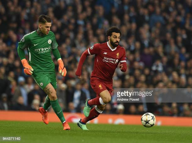 Mohamed Salah of Liverpool with Ederson of Manchester City during the UEFA Champions League Quarter Final Second Leg match between Manchester City...