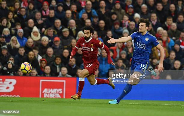 Mohamed Salah of Liverpool With Harry Maguire of Leicester City during the Premier League match between Liverpool and Leicester City at Anfield on...