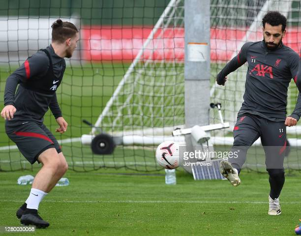 Mohamed Salah of Liverpool with Harvey Elliott of Liverpool during a training session at Melwood Training Ground on October 13 2020 in Liverpool...