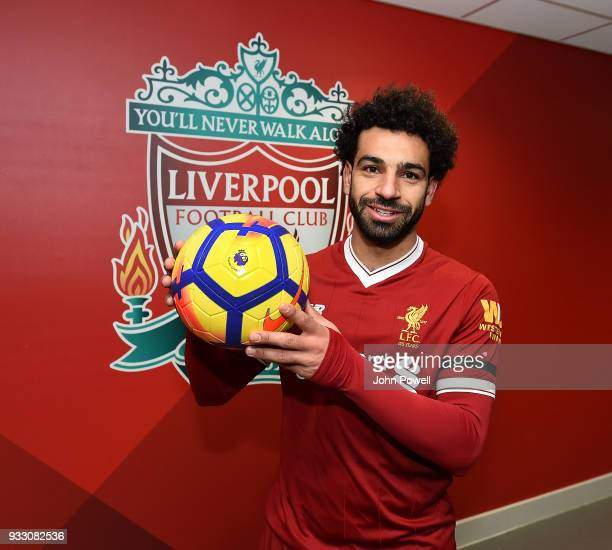 Mohamed Salah of Liverpool with his match ball Aafter scoring four goals during the Premier League match between Liverpool and Watford at Anfield on...