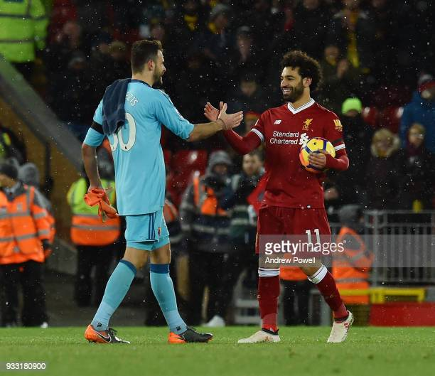 Mohamed Salah of Liverpool with his match ball after scoring four goals with Orestis Karnezis of Watford at the end of the Premier League match...