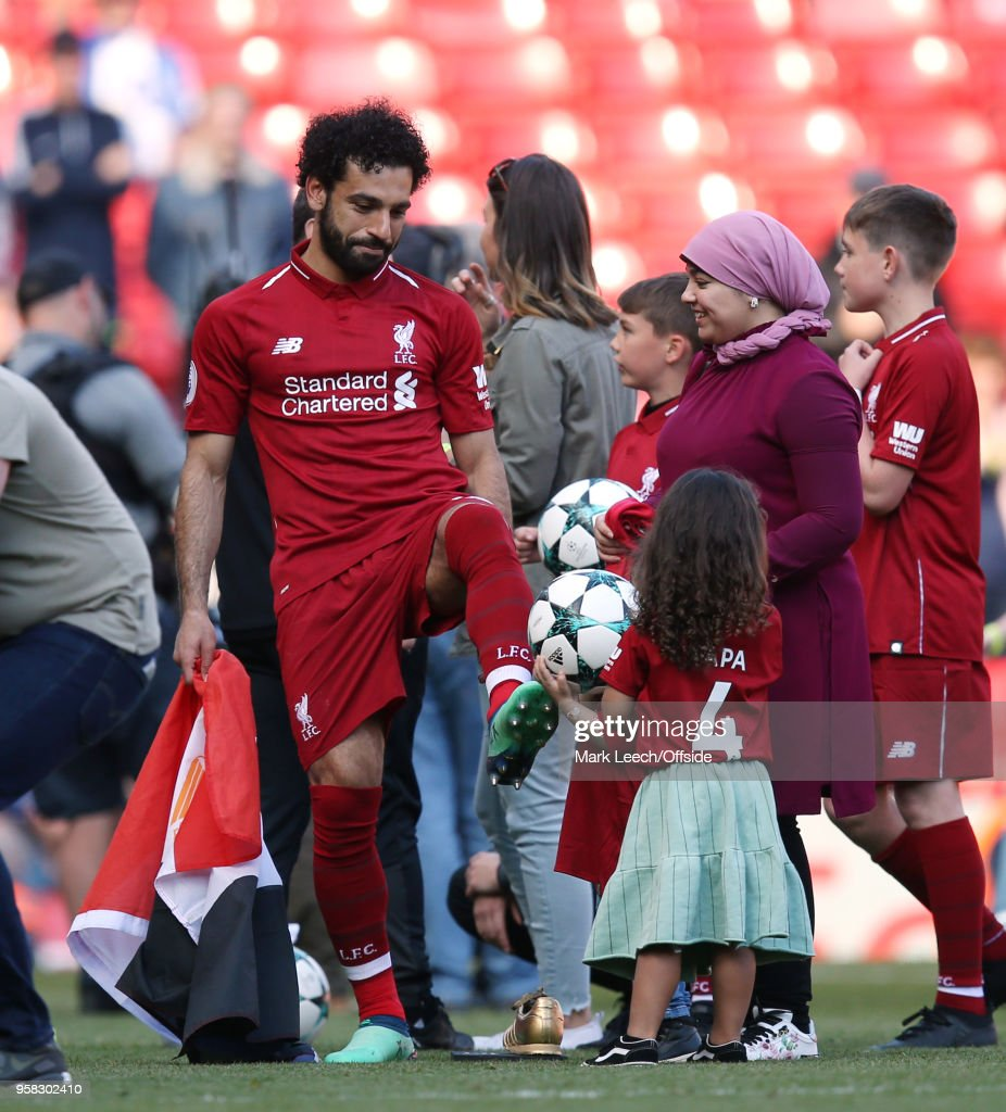 Mohamed Salah of Liverpool with his wife and children after the Premier League match between Liverpool and Brighton and Hove Albion at Anfield on May 13, 2018 in Liverpool, England.