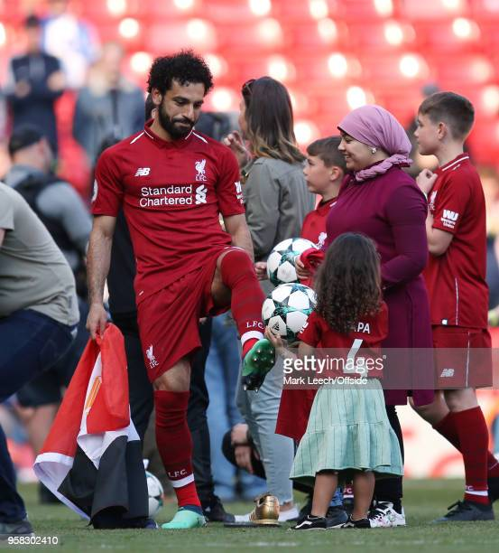 Mohamed Salah of Liverpool with his wife and children after the Premier League match between Liverpool and Brighton and Hove Albion at Anfield on May...