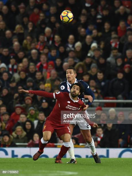 Mohamed Salah of Liverpool with Jake Livermore of west Brom during the Premier League match between Liverpool and West Bromwich Albion at Anfield on...