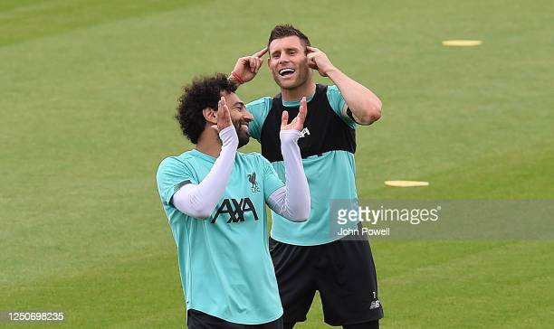 Mohamed Salah of Liverpool with James Milner of Liverpool during a training session at Melwood Training Ground on June 19 2020 in Liverpool England