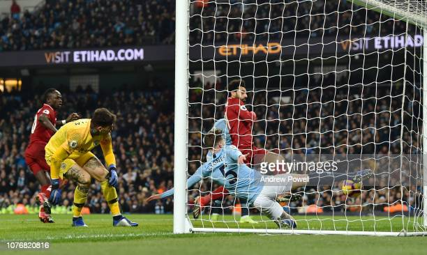 Mohamed Salah of Liverpool with John Stones of Manchester City during the Premier League match between Manchester City and Liverpool FC at Etihad...