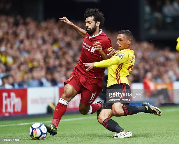 Mohamed Salah of Liverpool with Jose Holebas of Watford during the Premier League match between Watford and Liverpool at Vicarage Road on August 12...