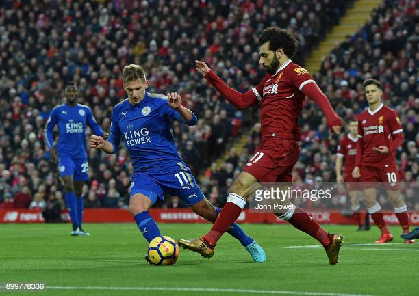Mohamed Salah of Liverpool with Marc Albrighton of Leicester City during the Premier League match between Liverpool and Leicester City at Anfield on...