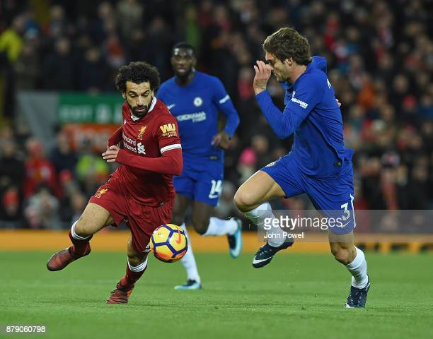 Mohamed Salah of Liverpool with Marcos Alonso of Chelsea during the Premier League match between Liverpool and Chelsea at Anfield on November 25 2017...