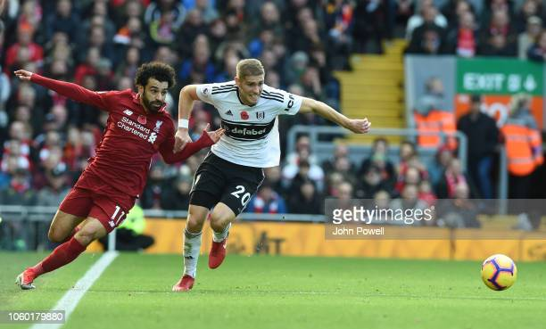 Mohamed Salah of Liverpool with Maxime Le Marchand of Fulham during the Premier League match between Liverpool FC and Fulham FC at Anfield on...