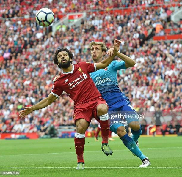 Mohamed Salah of Liverpool with Nacho Montreal of Arsenal during the Premier League match between Liverpool and Arsenal at Anfield on August 27 2017...
