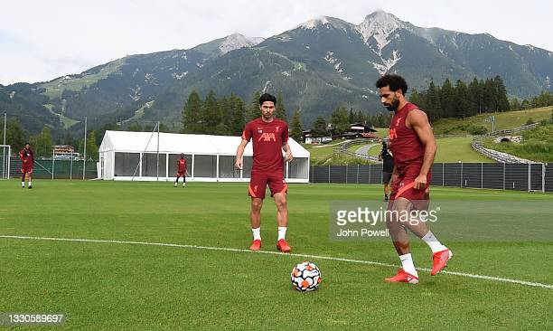 Mohamed Salah of Liverpool with Takumi Minamino of Liverpool during a training session on July 25, 2021 in UNSPECIFIED, Austria.