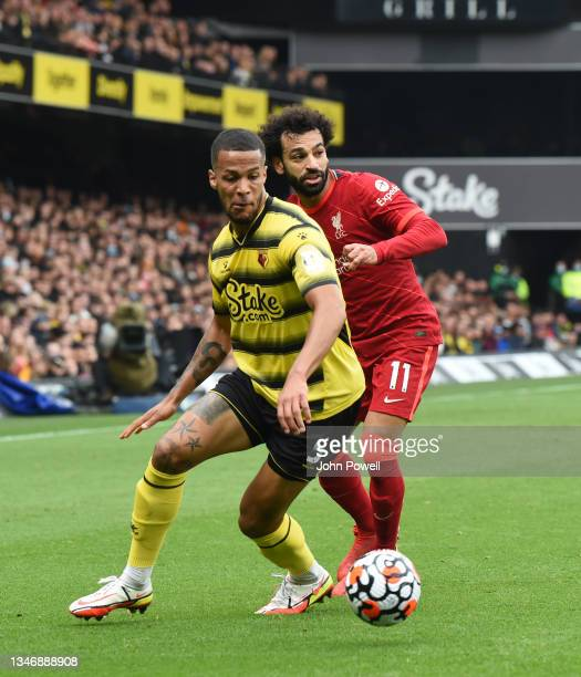 Mohamed Salah of Liverpool with William Troost-Ekong of watford during the Premier League match between Watford and Liverpool at Vicarage Road on...