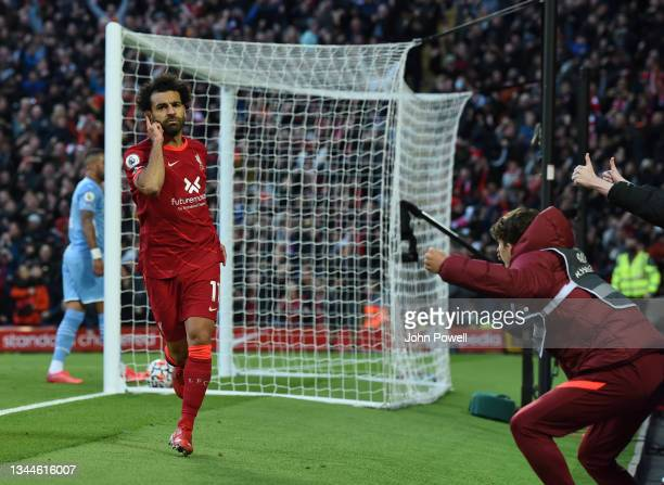 Mohamed Salah of Liverpoolcelebrates after scoring the second goal during the Premier League match between Liverpool and Manchester City at Anfield...