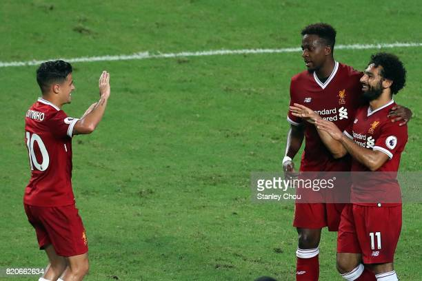 Mohamed Salah of Liverppol celebrates with Divock Origi as Philippe Coutinho looks on after scoring during the Premier League Asia Trophy match...